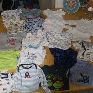 Bunch of onezies boys size 0 to 6 months